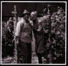 """Lucybelle Crater and close friend Lucybelle Crater in the grape arbor  (from """"The Family Album of Lucybelle Crater"""")  c. 1970 Estate of Ralph Eugene Meatyard     Need some ugly rubber masks. Hit up halloween stores next year, when funds allow."""