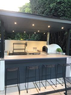 Fabricated steel frame above an outdoor bar, pizza … Pizza oven, outdoor kitchen. Fabricated steel frame above an outdoor bar, pizza oven and Argentinian grill. Small Outdoor Kitchens, Outdoor Bbq Kitchen, Pizza Oven Outdoor, Backyard Kitchen, Backyard Patio, Outdoor Bars, Kitchen Grill, Small Garden Kitchen, Modern Outdoor Pizza Ovens