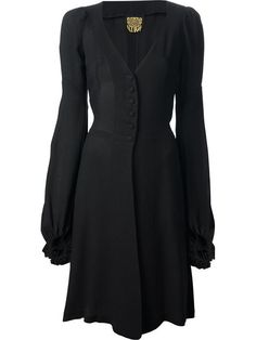 Black dress from Biba featuring a v-neck, a front button fastening, a fitted waist, bell sleeves and a back tie fastening.