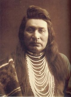 """Nez Perce warrior ~ 1899  ~  The Nez Perce are Native American people who live in the Pacific Northwest region (Columbia River Plateau) of the U. S.  An anthropological theory says they descended from the Old Cordilleran Culture, which moved south from the Rocky Mountains and west in Nez Perce lands. The Nez Perce nation currently governs and inhabits a reservation in Idaho. The Nez Perce's name for themselves is Nimíipuu (pronounced [nimiːpuː]), meaning, """"The People."""