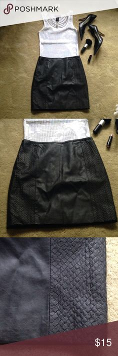 H&M black faux leather skirt A must have piece in your wardrobe. Black faux leather, lined skirt from H&M. Pattern detail at sides, plain in front. Back zip and clasp close. 85% viscose,15%polyester. 100%polyester lining. Size 4. (Nine West heels, butterfly shape rhinestone necklace and earring set, and white sequin tank sold under separate listings) H&M Skirts Mini