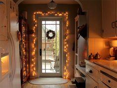 Love the small lights around back door. Poss for our sunroom door? Posie gets Cozy