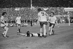 Arsenal player Charlie George lies on the ground and throws his arms in the air after scoring the winning goal during extra time for Arsenal during the FA Cup Final against Liverpool at Wembley. This win gave them the League-FA Cup double. In the background are teammates Frank McLintock and John Radford (1971)