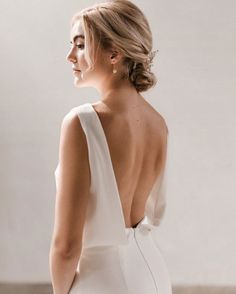 Margot is our most sophisticated, classic gown. With a beautiful and dramatic low back, Margot's bodice drapes gently across the bust, meeting a high snug waistline for an elegant silhouette. This simple wedding dress is perfectly suited to those with a refined taste. Ivory Wedding Veils, Wedding Gowns, Boat Neck Wedding Dress, Minimal Wedding Dress, Short Veil, Stretch Satin, Bridal Gowns, Snug, Bodice