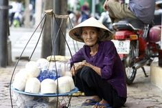 Vietnam-- buying fresh coconut water on the street for 50 cents