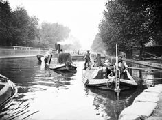 Steam Tug POWERFUL at the western entrance to Maida Hill tunnel with a train of empty Wideboats circa 1905. The tug would've been in the ownership of Thomas Clayton (Paddington) at this time, and the boats being empty suggests they would be being taken to loations for filling with waste Ash, Sweepings, Refuse etc., ready for return to Hillingdon for landfill in worked out gravel pits.