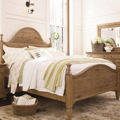 Featuring an arched silhouette and turned finial posts, this classic wood bed adds a country-chic touch to your guest room or master suite.
