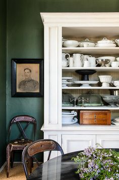 fantastic built-in shelves, wall color, old portraits and furniture Decor, Home Kitchens, Green Interiors, Dark Green Walls, Interior, House, Modern Dining, Home Decor, House Interior