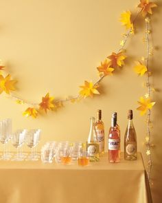 Dress up a serving table or add some sparkle to a photo booth with these easy-to-make paper-flower lights. To add drama, use a bright, bold shade of vellum on the big flowers and an understated, light shade on the daises. For a playful look, place uneven numbers of daisies between the larger flowers. Use only daisies near the ends of the strand to avoid weighing down the lights.