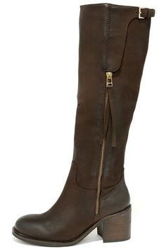 "We know you're anxious to start wearing the Steve Madden Antsy Brown Leather Knee-High Boots, but we promise they're worth the wait! These gorgeous genuine leather riding boots will be an everyday favorite, with a rounded toe and a few curated accents along the 15.5"" shaft (including a gold zipper and buckled flap). 16"" working zipper at the instep. Gusseted collar has a 15"" interior circumference. 2.5"" stacked block heel. Cushioned insole. Nonskid rubber sole. Available in whole and half…"