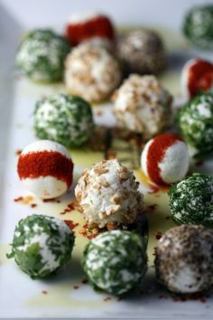 fun food project to do with the kids! use garden herbs and olive oil to coat goat cheese balls. yum!
