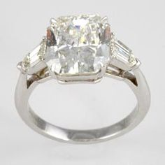 Center Diamond 4.48 Carat Radiant-Cut With .75 Carat Total Weight Modified Bullet-Cut Side Diamonds, Ring Hand Fabricated In Platinum. Available at Underwood Jewelers