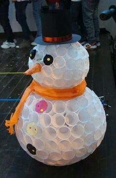 Snow man made out of plastic cups
