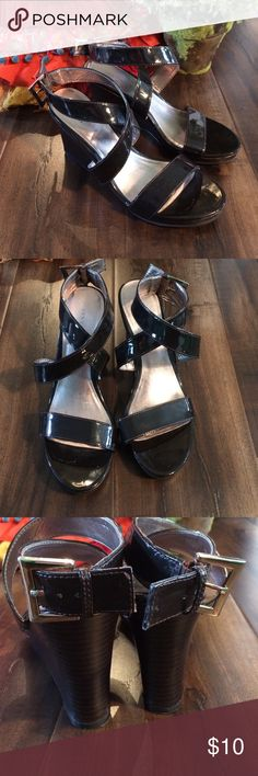 Ann Taylor wedge patent leather brown sandals Ann Taylor size 8 wedge patent leather brown sandals. Worn a few times. Shows normal wear, still in good condition. Ann Taylor Shoes Wedges