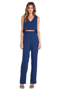 Knock out two trends with one stone in this d.RA jumpsuit with faux crop top.  A dramatic back elevates this ready-in-five look #REVOLVEclothing