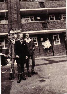 Three well dressed baldies.