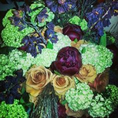 Combo roses.  Red charm peonies. Vibirnum. Black Frittilarya and some plume grass stuff ;)