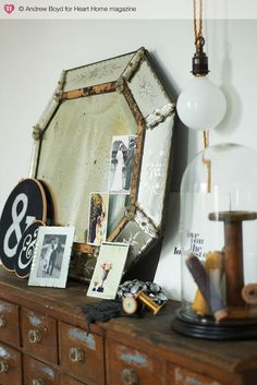 I love this antique mirror with the old photos tucked in the side. A really nice arrangement.