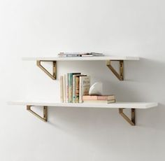 RH TEEN's Geometric Metal Bracket Wood Shelf:Solid wood planks offer streamlined simplicity, making them the ideal resting space for books, photos and one-of-a-kind objects.