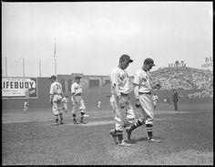 1937 -Boston Red Sox coach Herb Pennock, Boston Red Sox shortstop/manager Joe Cronin, unidentified Boston Red Sox player, and Boston Red Sox third baseman Pinky Higgins.