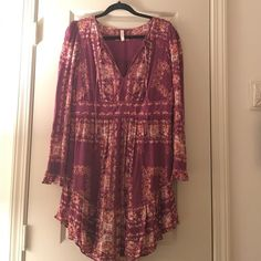 Free People Floral Swing Dress Fun and flirty plum floral swing dress, longer in the back. Wore once! Free People Dresses Midi
