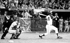 Hank Aaron breaks Babe Ruths record for career home runs as he hits No. 715 on April 8, 1974.