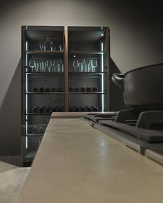 Large shelf with glass doors in the kitchen doubles as a display