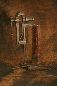 Blacksmith's post vise - a necessary tool. You can put a piece in the vice, and the post supports the vise while you hammer and bend the piece.
