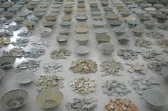 Installation of 900 whole and broken porcelain bowls by Chinese artist He Xiangyu
