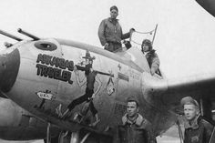 """U.S. Air Force photograph of Lt. James O. Fincher of the 392nd Fighter Squadron, 367th Fighter Group in his P-38J Lightning """"Arkansas Traveler"""" along with his ground crew. The P-38 was photographed at Clastres Airfield, France in October 1944."""