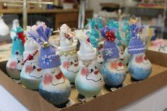 @Christal Slater, remember when we painted a couple of dozen of these at Dad's house. Think we could ever get those back?! May just have to make more. snowman ornaments made from old lightbulbs