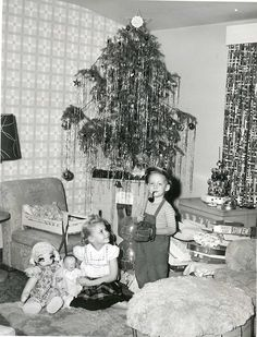 Awesome tinsel job on the tree! I also love how the little boy is just chillin' with his baseball gear, smokin' his pipe.