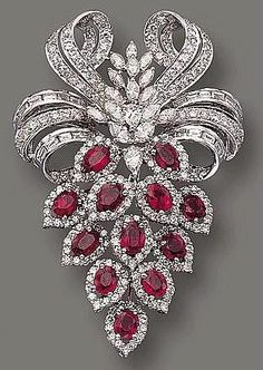 Ruby and diamond brooch cartier, I would wear it in my hair.