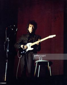 Bob Dylan plays a Fender Telecaster electric guitar as he performs on stage at the Westchester County Center on February 5, 1966 in White Plains, New York.