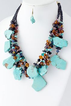 $58 Raw Turquoise accented with Crystals beautifully finished with Royal Blue Crystal Seed Beads. Necklace set includes Dangle Turquoise Earrings.