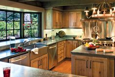 Canyon Creek Valley Forge Solid rustic alder in Taupe w/Licorice glaze with green stone counter tops and stainless steel apron sink
