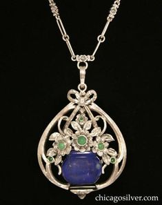 """Necklace, composed of silver pendant with stones and ornate  paperclip chain.  2-1/8"""" H and 1-5/8"""" W on 15-1/8"""" L chain. Marked F.W.L. for F. Walter Lawrence Inc."""
