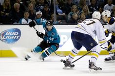 San Jose Sharks forward Logan Couture puts on the breaks (Nov. 5, 2013).
