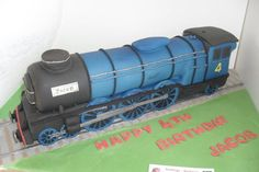 Train cake  Cake by davidmason  I love how realistic this train looks...but the rest of the cake is lacking.