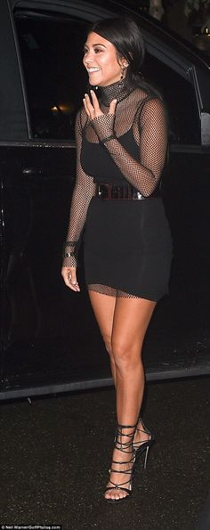 In the City of Light: Kourtney Kardashian went clubbing in Paris on Friday night in a black mini dress with mesh sleeves and bodice and some very strappy heels
