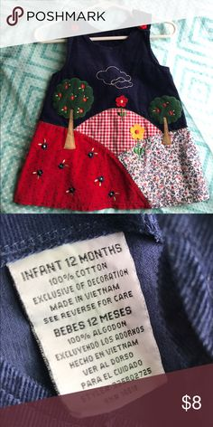 Precious patchwork baby girl dress❤️ Super sweet baby dress. Corduroy material, 100%cotton, 12month, patchwork dress with trees, hills, flowers and adorable design! Red flower buttons on straps and embroidered cloud designs on front. Worn once with turtle neck and tights underneath! Make an offer or bundle to save! BoGo and discounts for sets!❤️ Dresses Casual