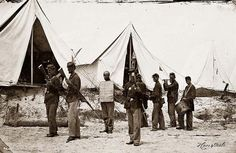 """Drumming A Thief Out Of Camp: You are viewing an important image of Morris Island, South Carolina. The """"rogue's march"""" drumming a thief out of camp. It was taken in 1863 by Haas & Peale."""