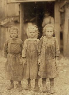 Aw..look at the bandages on their little fingers. Josie, six year old, Bertha, six years old, Sophie, 10 years old, all shuck regularly. Maggioni Canning Co. Location: Port Royal, South Carolina, Lewis Hine, Febraury 1911