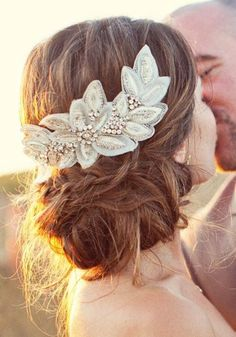 Romantic bridal hairstyle with a vintage-looking accessory that looks beautiful!