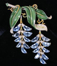 "Trifari enamel and rhinestone flower brooch with hinged dangling blue wisteria blossoms.  3"" x 3.5\"".  Excellent condition. Sold $1,750"