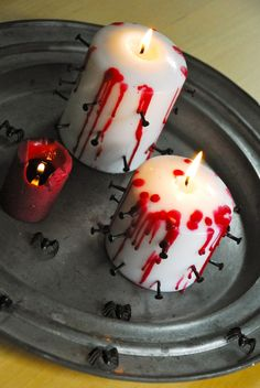 No halloween is complete without Bloody Candles to raise your spirits-made with nails and dripped red candle wax for blood effect. #Halloween #Crafts and #Ideas