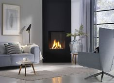 Gas fireplace / contemporary / closed hearth / built-in TRIMLINE ThermoCet BV Corner Gas Fireplace, Bedroom Fireplace, Home Fireplace, Modern Fireplace, Living Room With Fireplace, Fireplace Design, Corner Stove, Freestanding Fireplace, Family Room