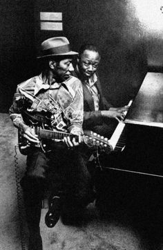 Identified as 'Hound Dog' Taylor & Pinetop Perkins.  But I'm not convinced the piano player is Perkins.