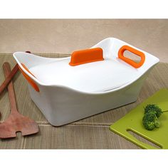 """I am a huge fan of one-dish meals so I was thrilled to see this porcelain baking dish come through the office. The sleek styling and timeless white finish take it from oven to table for either a weeknight family dinner or a fancier, """"company's coming"""" affair. The heavy-duty casserole dish and lid have a pop of color from the orange silicone on the handles that helps make handling a little easier. This is definitely my new favorite bakeware. I will be using it to make everything from hot…"""