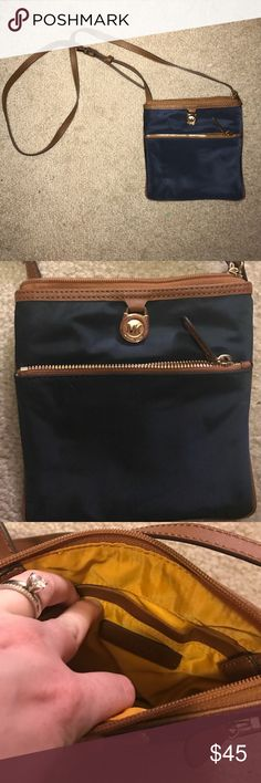 Michael kors satchel Navy blue and brown michael kors satchel. Small and perfect for a day out where you don't want to lug around a big purse. Interior is yellow, and I haven't used it once. Michael Kors Bags Satchels